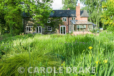 Old mill house. Westonbury Mill Water Garden, Pembridge, Herefordshire, UK