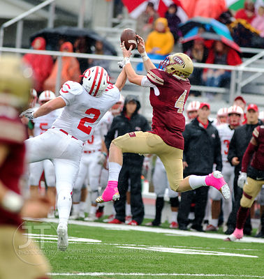 Coe College's Tyler Schamel (4) comes down with a reception over Central's Tyler Olson (2) during the second half of play at ...