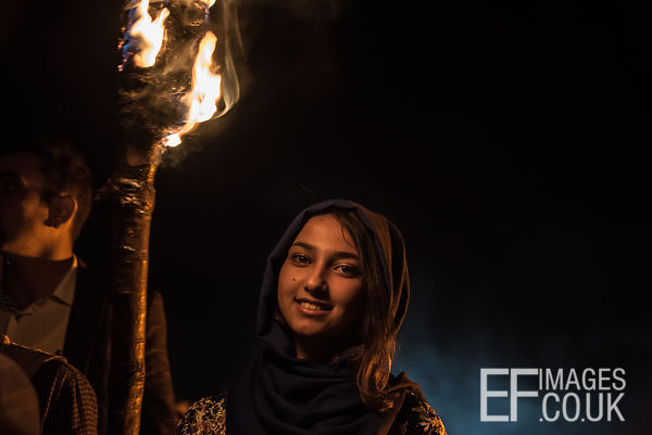Beautiful Kurdish Girl Carrying A Newroz Torch