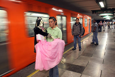 The faithful go by metro to the altar of the Santa Muerte in Tepito neighborhood for the Rosary That takes up on the first da...