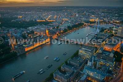 Aerial view of the River Thames and Houses of Parliament at night, London