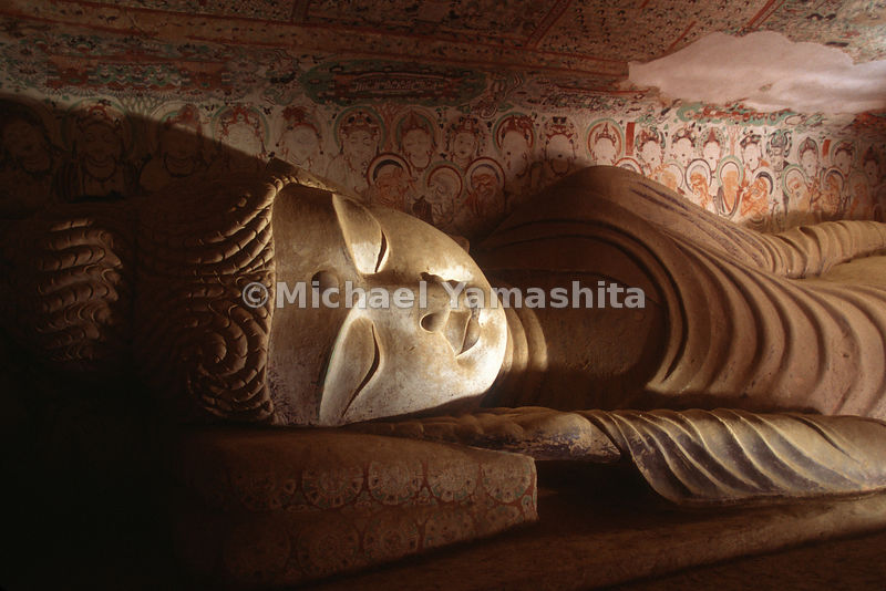 A reclining Buddha sleeps peacefully at the Mogao Caves, near Dunhuang.  Also known as the Caves of the Thousand Buddhas, the site dates to the 4th Century BC. With over 1000 caves and 492 temples, this treasure trove contains some of the finest examples of Buddhist art spanning over 1000 years.