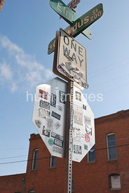 Crowdus and Elm Streets stop sign, one way sign, in Deep Ellum, Texas