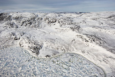 Aerial view of mountains and melting pack ice. Jakobshavn, Ilulissat, Kangia, Icefjord, Greenland. October 2008.