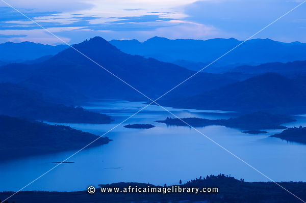 Rwanda, Lake Burera outside Ruhengeri surrounded by volcanos