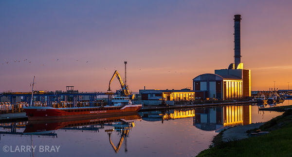 power station and ship reflecting the sunset in Shoreham-by-Sea, West Sussex, UK