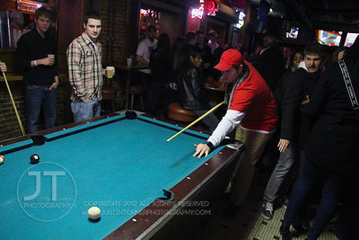 Patrons play pool at the Sports Column, 12 S. Dubuque Street, in downtown Iowa City Saturday night. Copyright Justin Torner 2...