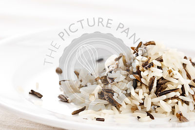 Long rice mixed with wild rice on white background