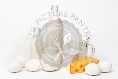 Breakfast - milk, eggs, yoghurt, cheese on white background