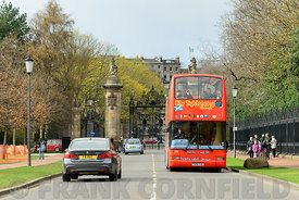 EDINBURGH, SCOTLAND – APRIL 16, 2016: Tourist sightseeing bus tour of landmarks in the city of Edinburgh, Scotland.  The bus ...