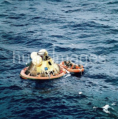 (24 July 1969) --- The three Apollo 11 crew men await pickup by a helicopter from the USS Hornet, prime recovery ship for the...