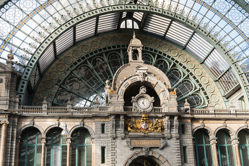 2018-10-01 Antwerp, Belgium: Clock at 5 pm and Antwerp Coat of Arms at Central Station