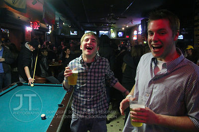Patrons react to the camera at the Sports Column, 12 S. Dubuque Street, in downtown Iowa City Saturday night. Copyright Justi...