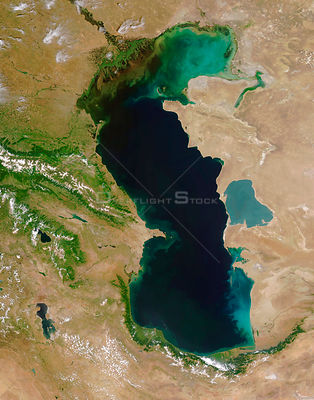 EARTH Caspian Sea -- 11 Jun 2005 -- Swirling clouds of sediment and phytoplankton float in the waters of the Caspian Sea.