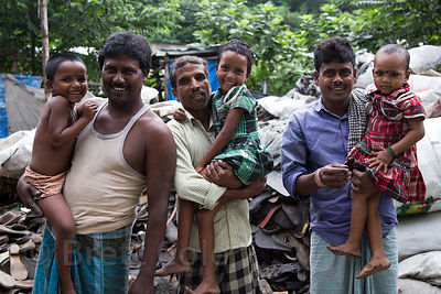 Families working in rubber shoe recycling, Dhapa, Kolkata, India. Dhapa is a large industrial zone that processes most of Kolkata's garbage and recycling.
