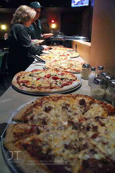 Pizza is laid out for a private party at Airliner Bar, 22 S Clinton Street in downtown Iowa City Saturday night. Copyright Ju...