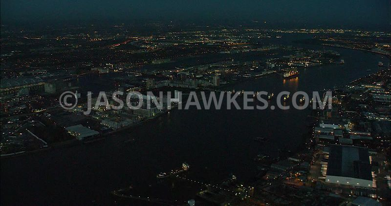 London night aerial footage, Thames Barrier at night.