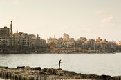 fisherman at the waterfront at the Mediterranian sea, Alexandria, Egypt