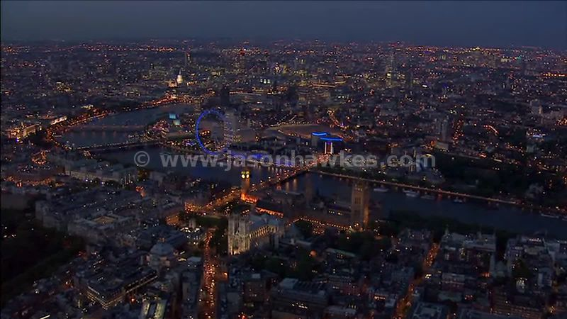 Aerial footage over the Houses of Parliament and Waterloo at night, London, England, UK