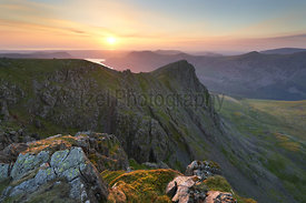 Sunset over Ennerdale Water from Scoat Fell with views of Steeple In the English Lake District, UK.