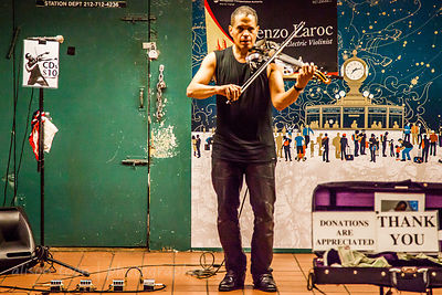 Lorenzo Laroc, electric violinist, performing in subway station in New York