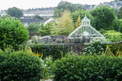 View across the Vean Garden to the conservatory and Truro beyond. Bosvigo, Truro, Cornwall, UK