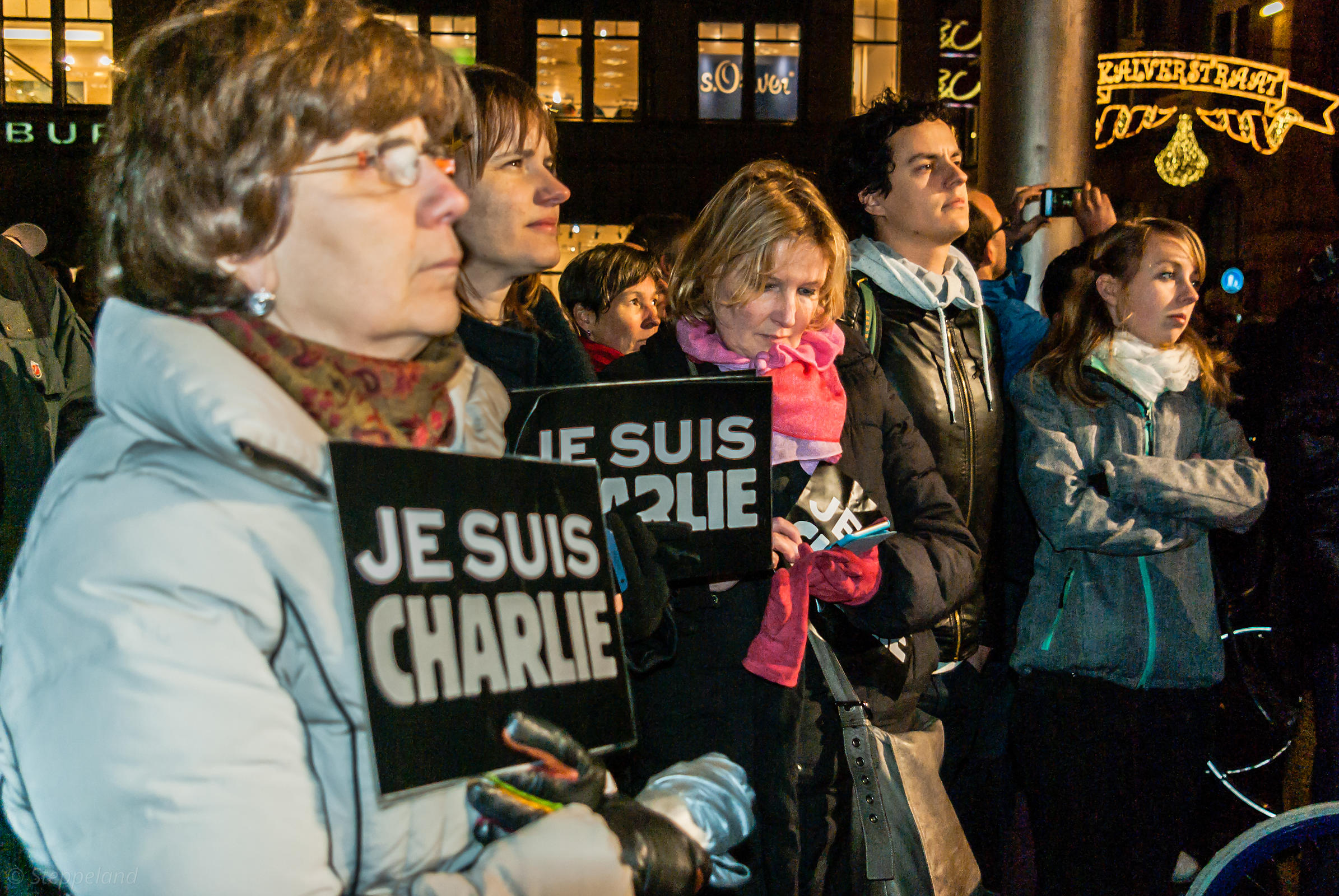 Amsterdam, Netherlands 2015-01-08: People holding signs: 'Je suis Charlie' while they listen to the speeches.