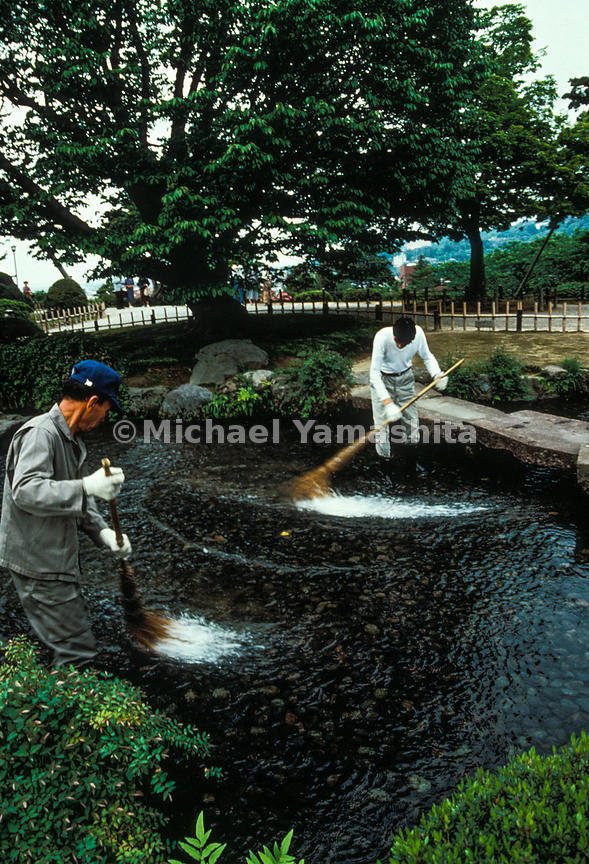 "To ensure that the waters run crystal clear in the streambed at Kenrokuen, ""river washers"" labor from morning till dusk, sweeping algae from the stones."