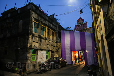A Durga Puja pandal on a street in Bowbazar at night, Kolkata, India.