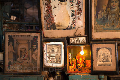 Ganesh idol and religious paintings at a market stall in Newmarket, Kolkata, India.