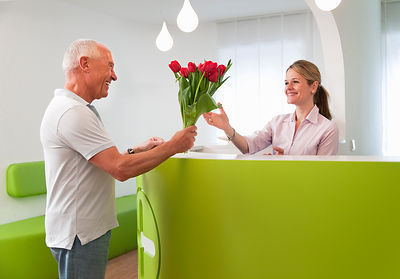 Patient thanking receptionist