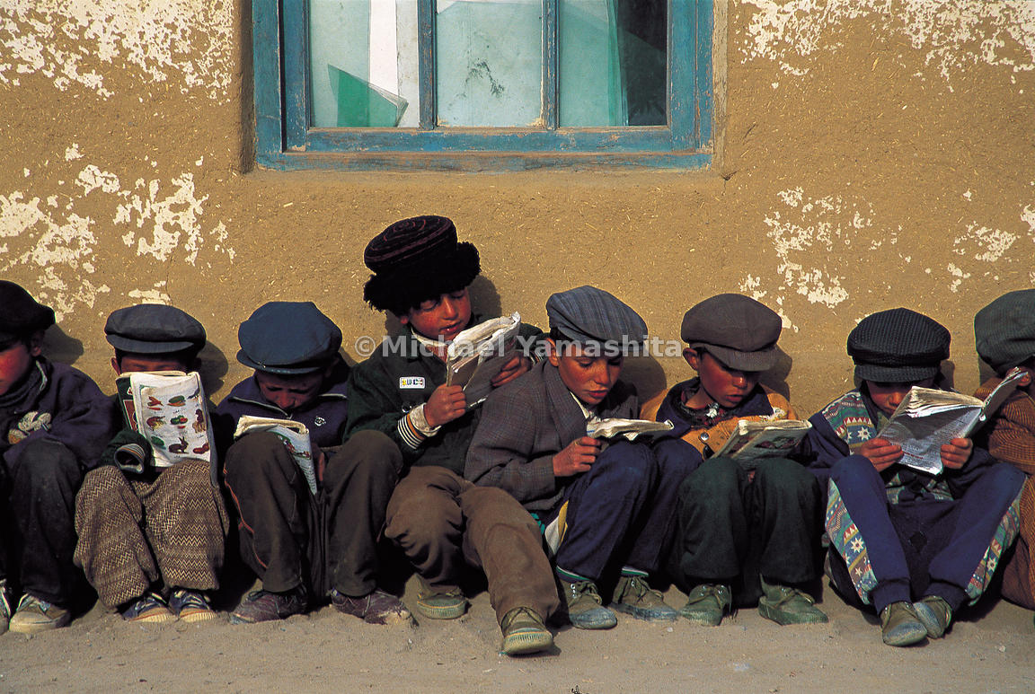 Tajik schoolboys wait for their lessons to start. In this corner of the world, males wear blue, while females wear red.