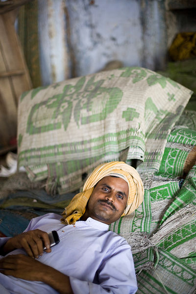 India - New Delhi - Men rest inside one of the buildings in the Chiragh-i-Delhi Dargah