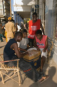 Mozambique, Beira, boys playing a game of drafts on Municipal Square.