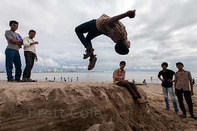 A group of breakdancers practice on Chowpatty Beach, Mumbai, India.