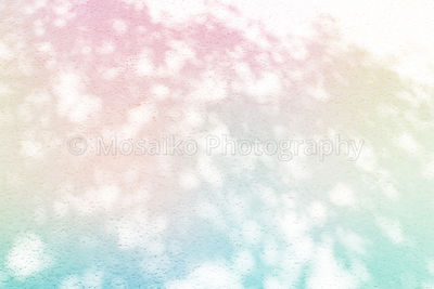 spotted lights on textured background - rainbow colors