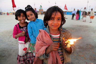 A group of girls perform puja (prayer) at the 2013 Kumbh Mela, Allahabad, India.