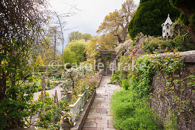 Stone terrace above the Sunken Garden leads to a summerhouse. Holker Hall, Grange over Sands, Cumbria, UK