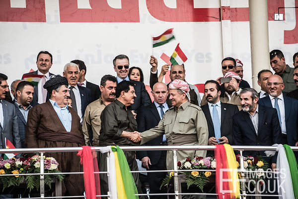 Iraqi Kurdistan President Barzani shakes hands with dignitaries at the final Kurdish independence referendum rally, held at t...