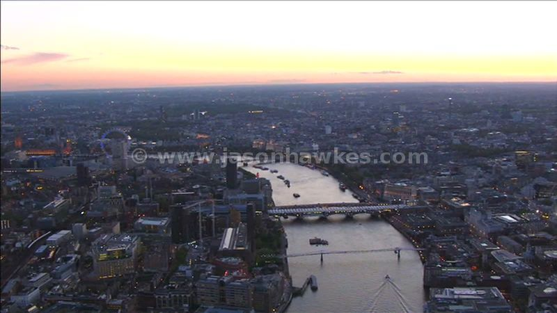 Aerial footage over the River Thames at dusk, London, England, UK