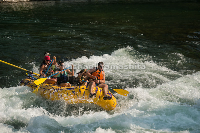Whitewater rafting/kayaking on Snake River, south of Jackson Hole. Grand Teton National Park, Wyoming...Jagged peaks of the T...