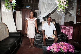 Vanilla producer 43-year old Patrick Razafiarivo poses with his wife Lalao in their living room on May 26, 2016 in the munici...