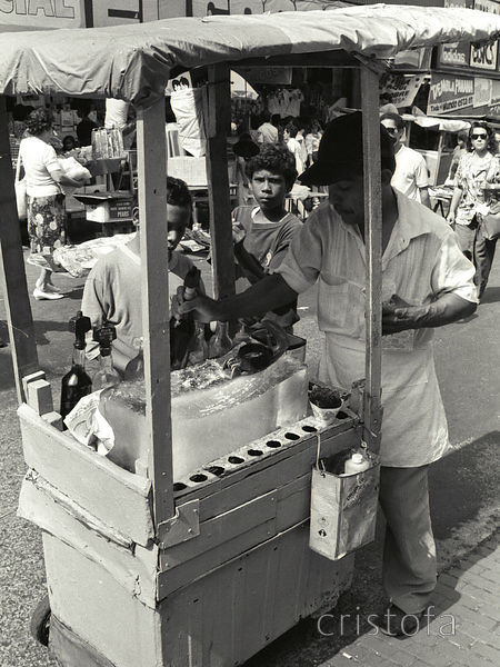 a trader prepares an ice cone in Panama City