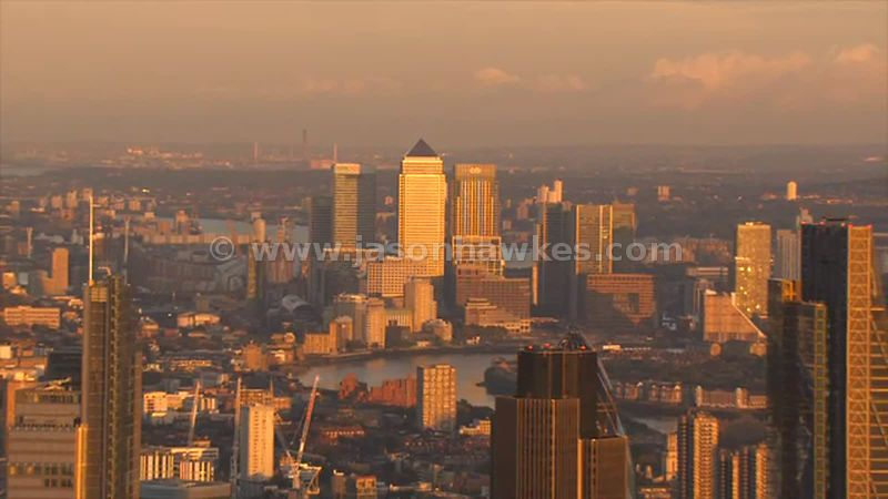 Aerial footage of Canary Wharf and the City at sunset, London