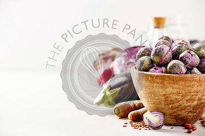 Purple Brussels sprouts in a wooden bowl