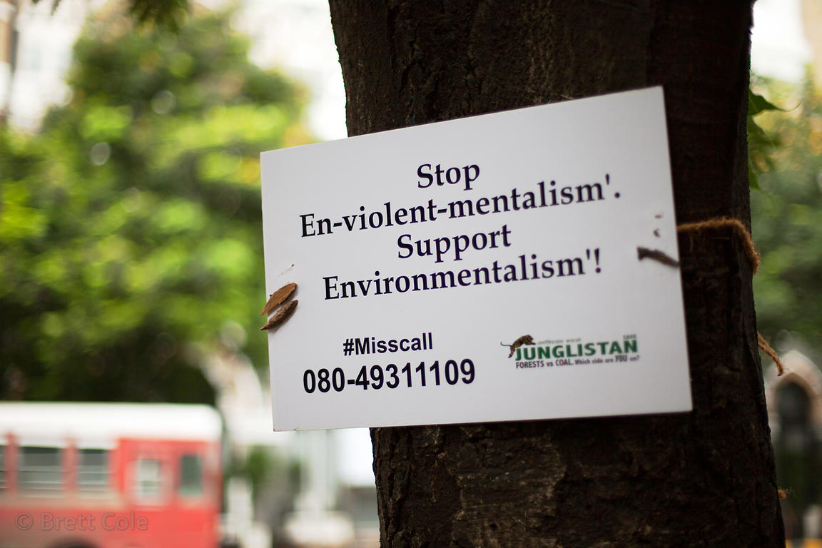 Sign supporting environmental conservation on a tree near Crawford Market, Mumbai, India.
