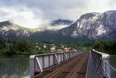 Railroad tracks in Squamish, British Columbia, with the Squamish Chief in the background. The Chief is the second largest gra...