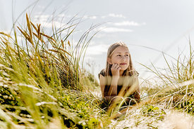 Girl in the dunes in Denmark 2