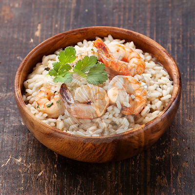 Shrimps Risotto in wooden bowl