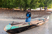 Woman on the beach with fishing boat, Toliara, Madagascar